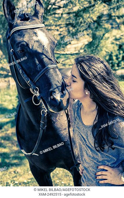 Young girl and horse. Ayegui, Navarre, Spain