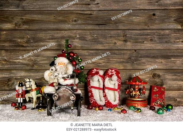 Nostalgic wooden christmas decoration with old children toys on the background