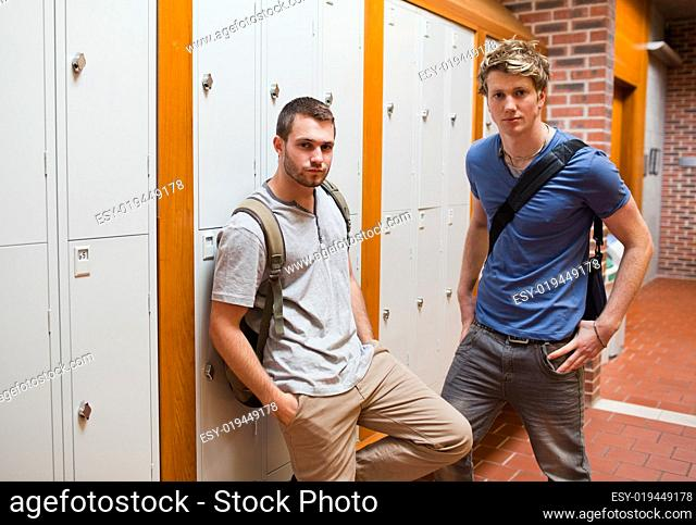 Handsome students standing up