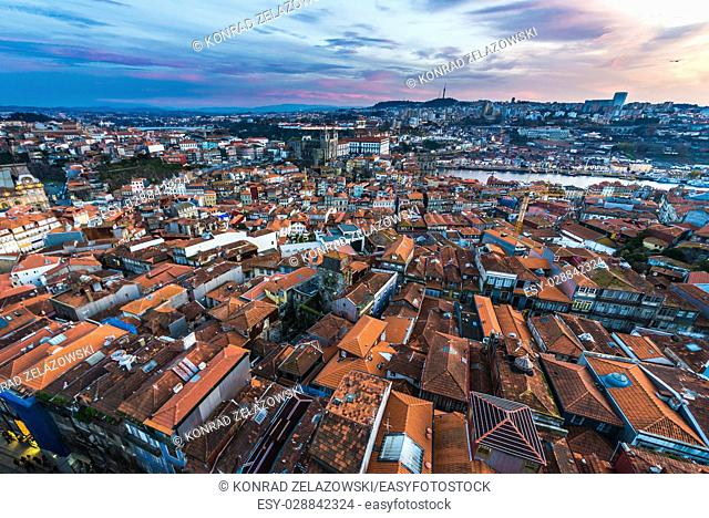 Sunset over Porto and Vila Nova de Gaia, Portugal. View from bell tower of Clerigos Church with Se Cathedral