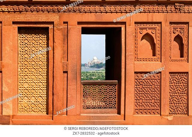Agra, Uttar Pradesh, India. Taj Mahal- As Seen from Agra Fort Window. Near the gardens of the Taj Mahal stands the important 16th-century Mughal monument known...