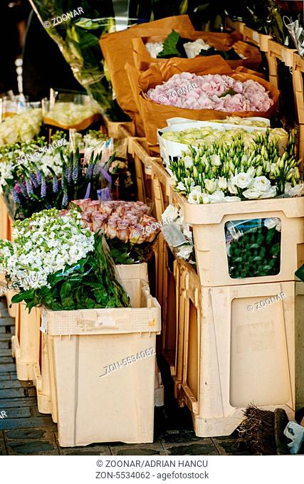 London's typical flower street market with roses, tulips, freesia and other flowers