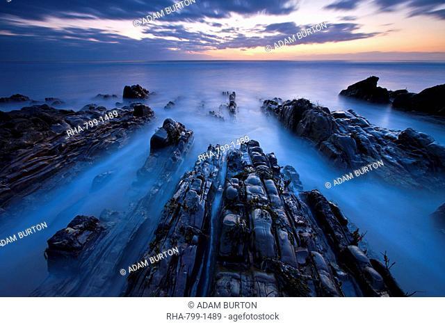 Advancing tide on the rocky ledges of Sandymouth, Cornwall, England, United Kingdom, Europe