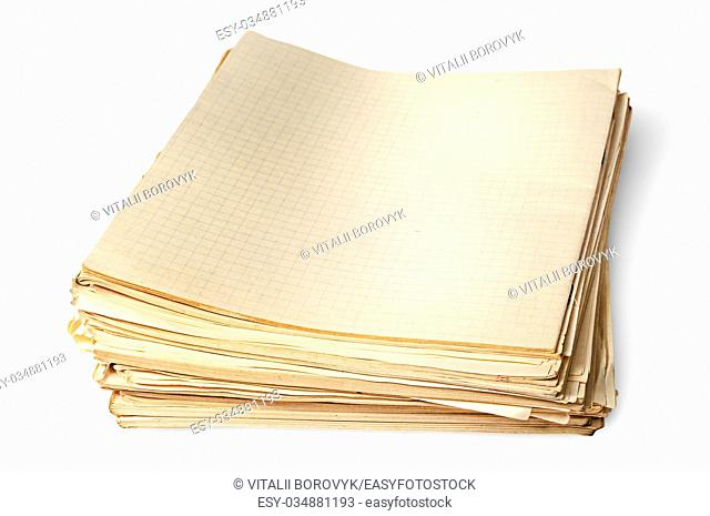 Stack of old yellowed sheets of school notebooks top view isolated on white background