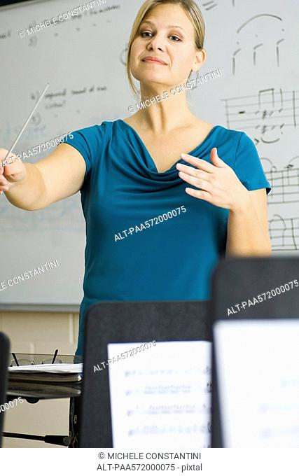 Music teacher conducting