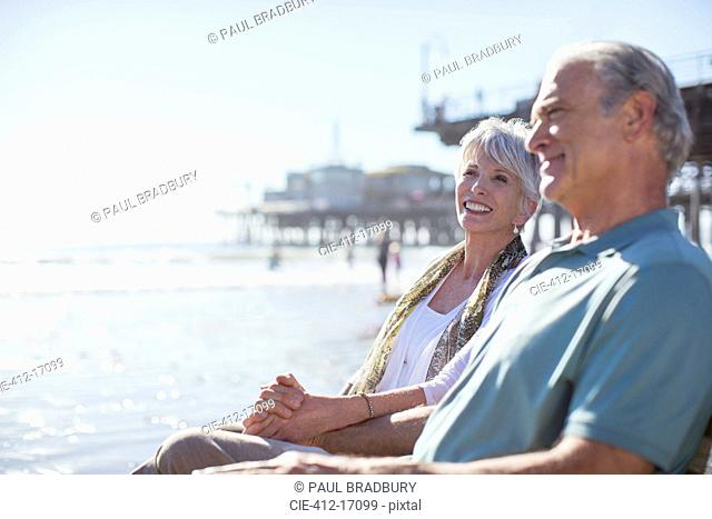 Senior couple relaxing on sunny beach