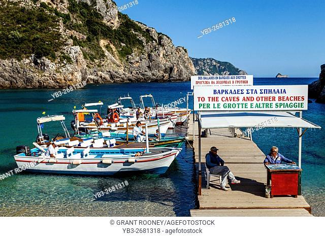 Local Boat Captains Waiting For Business, Paleokastritsa, Corfu Island, Greece