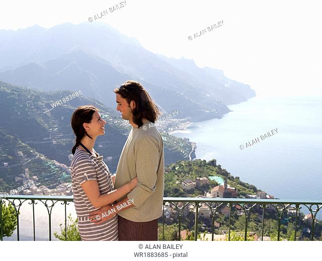 Italy, Ravello, Couple embracing on terrace