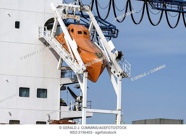 Rotterdam, Netherlands - April 17, 2018: An Unsinkable, totally enclosed, free-fall lifeboat made of plastic, on angled launch platform at the rear of a cargo...