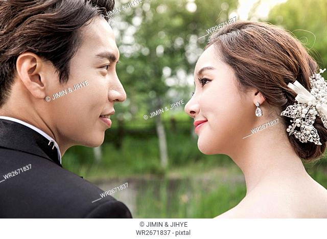 Side view portrait of romantic wedding couple