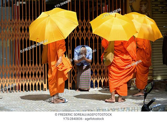 Buddhist monks on their morning alms round,Phnom Penh, Cambodia,Indochina,Southeast Asia,Asia