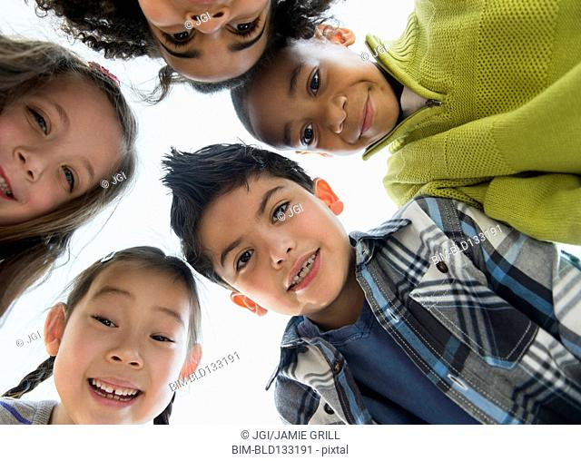 Children smiling in huddle