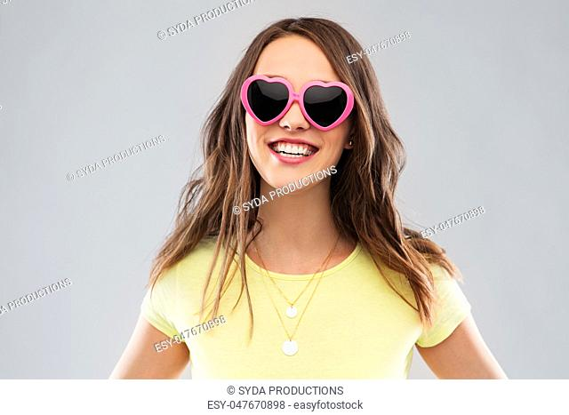 teenage girl in heart-shaped sunglasses