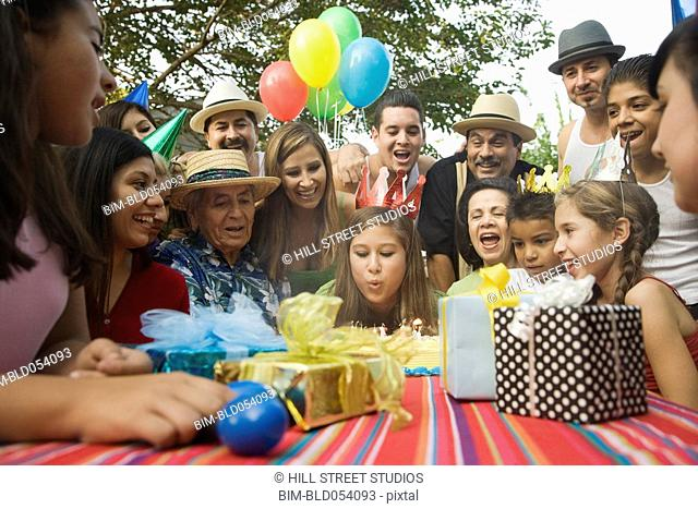 Hispanic girl celebrating birthday with family