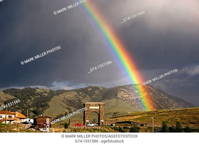 Rainbow and Roosevelt Arch at North Entrance Yellowstone National Park USA