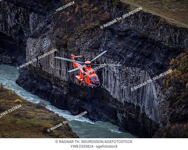 Aerial view-TF-SYN, Search and Rescue Helicopter flying by Gullfoss Waterfalls, Iceland