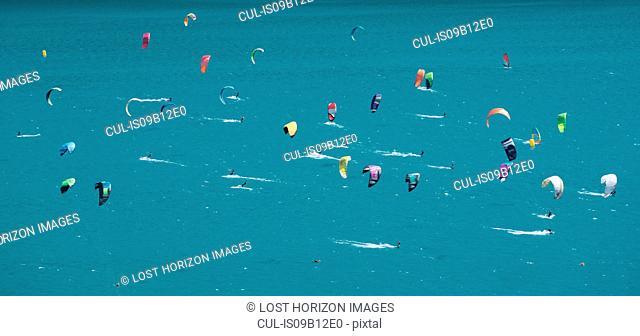 Large group of kitesurfers on turquoise lake, Canton Graubunden, Switzerland