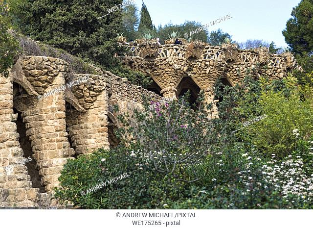 Colonnaded footpath and birds nests built by Gaudi at Park Guell, Barcelona, Spain