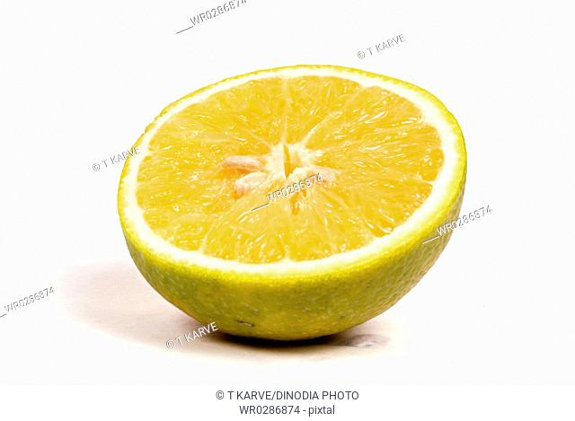 Fruits , half cut inside golden and outer yellow color sweet lime on white background