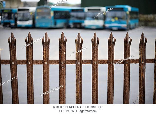 Buses awaiting repair behind a security fence, Aberystwyth, Wales