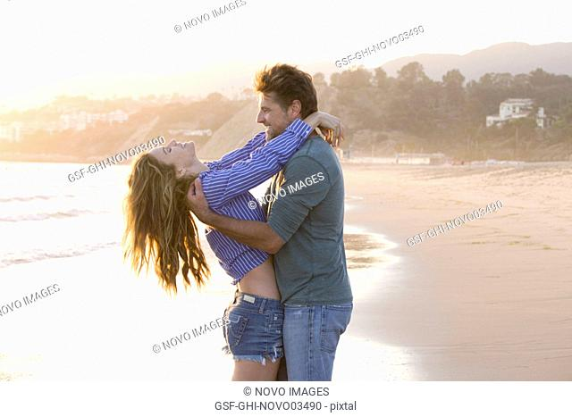 Carefree Mid-Adult Couple at Beach
