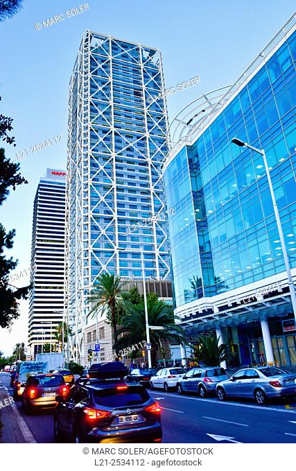 Hotel Arts and Mapfre tower at sunset. Cars in row at Avinguda del Litoral avenue. Barcelona, Catalonia, Spain