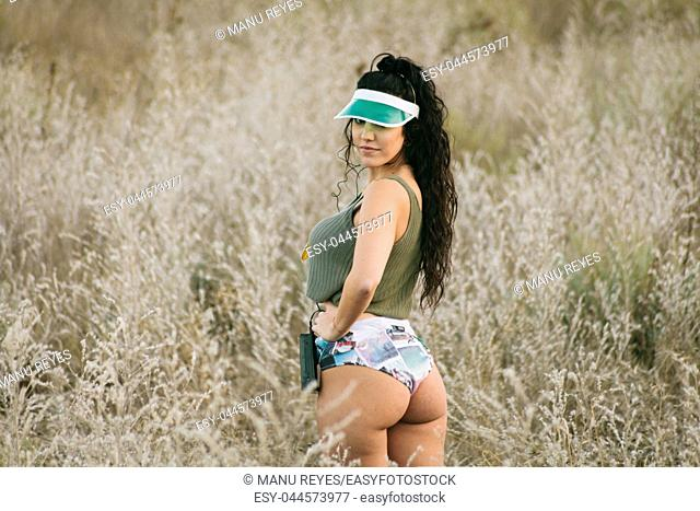 Young brunette woman listens to music in old cassette