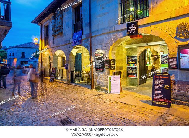 Facades of shops and restaurants, night view. Santillana del Mar, Cantabria, Spain