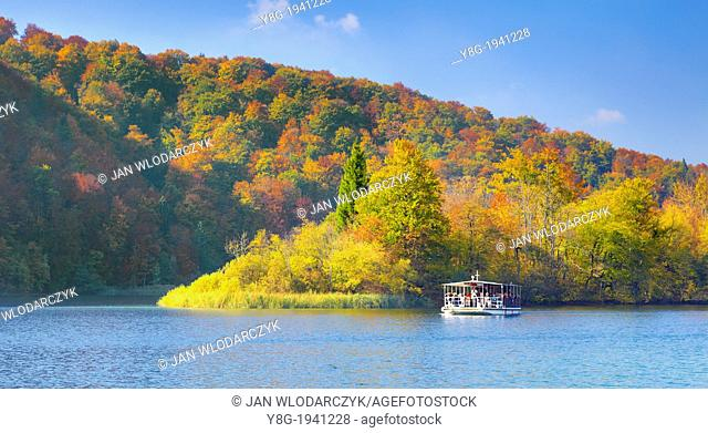 Croatia - autumn landscape of Plitvice Lakes National Park, electric power ferry boat on the lake, Plitvice, central Croatia