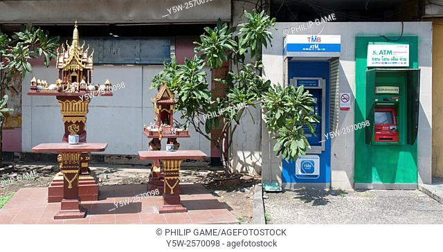 Buddhist shrines beside ATMs (cash machines) in Bangkok, Thailand