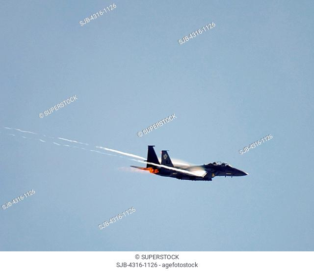 A US Air Force F-15E Strike Eagle Makes a High G Turn, Sending Condensation Banners off of Its Wing Tips