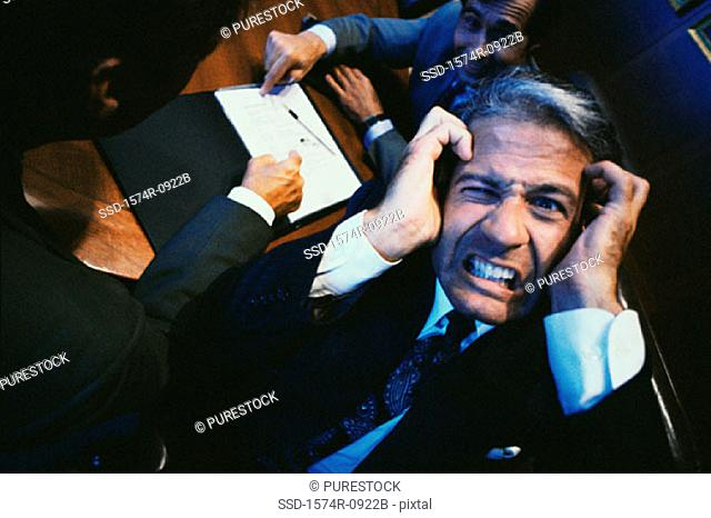 Businessman holding his head in stress