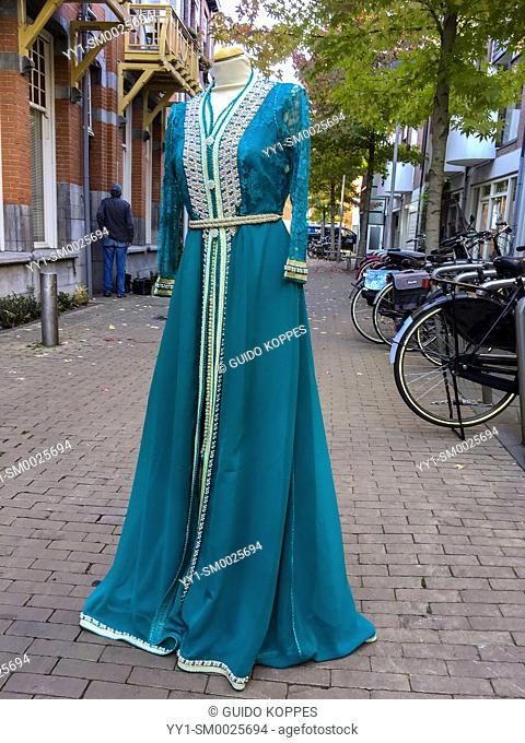 Tilburg, Netherlands. Mannequin outside a Moslima fashion store down town, wearing a traditional, Maroccan Dress, attracting female customers to buy new...