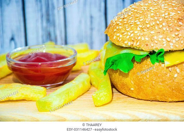 Homemade ukrainian burger on isolated wooden background