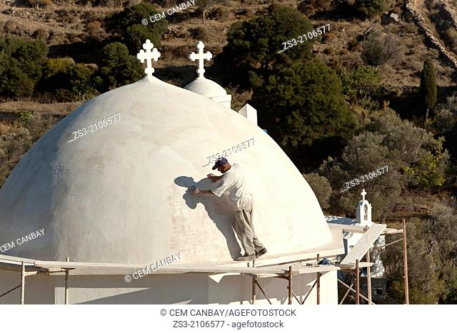 Worker at the dome of a church, Naxos, Cyclades Islands, Greek Islands, Greece, Europe