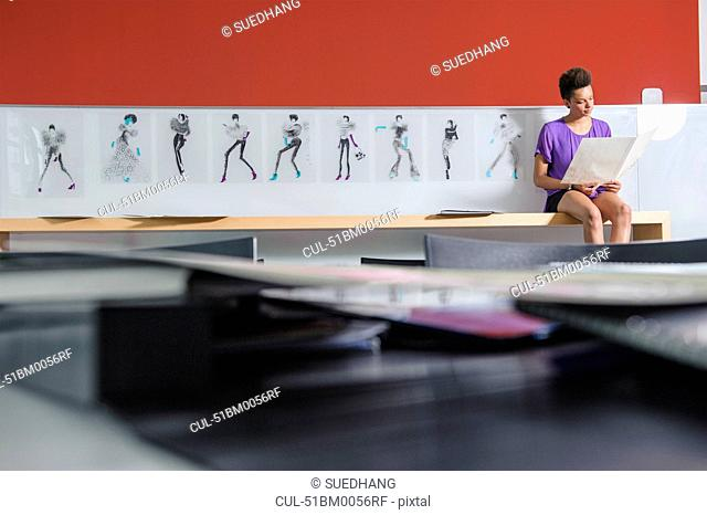 Businesswoman reading in office