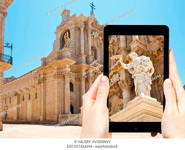 tourist taking photo of Apostle statue in Syracuse