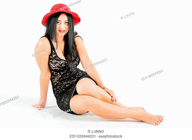 Young photo model in the photo studio with white background