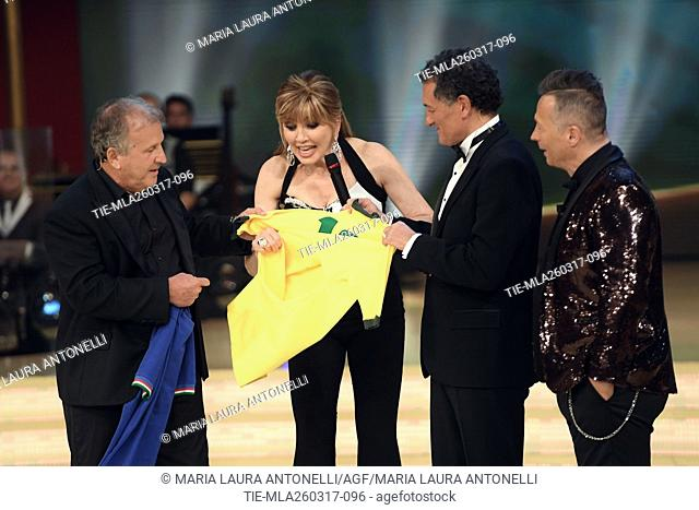 The former football players Arthur Antunes Coimbra ' Zico ' and Claudio Gentile exchanging shirts of Brazil and Italy, with Milly Carlucci and Paolo Belli...