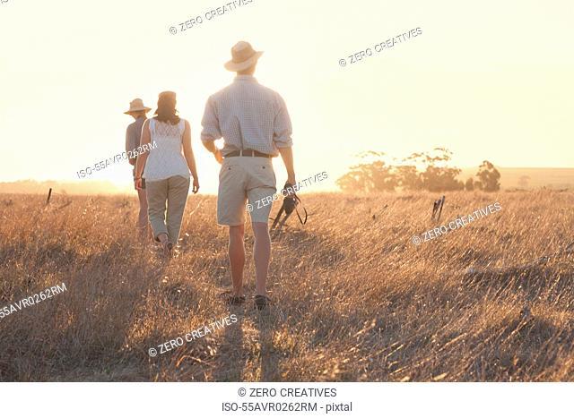 People walking through grass on safari, Stellenbosch, South Africa