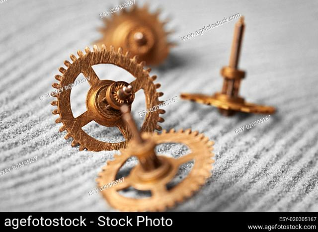 Watch gears on sand - abstract still life