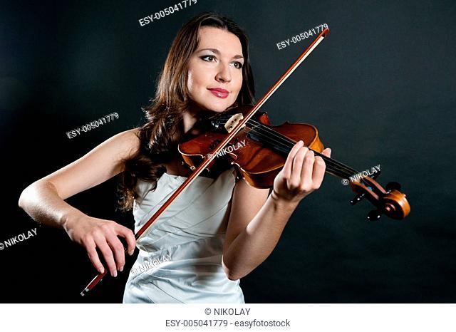 violinist on black background