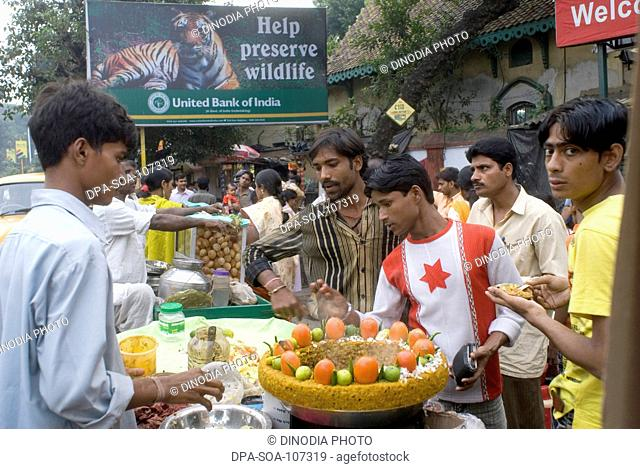 Chat Vendor Preparing dish on the street  at alipore zoo  ; Kolkata ; West Bengal ; India