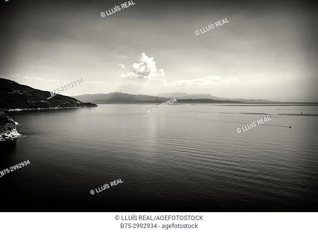 Corsega coastline, clouds and distant ship Corsega, Mediterranean Sea, France