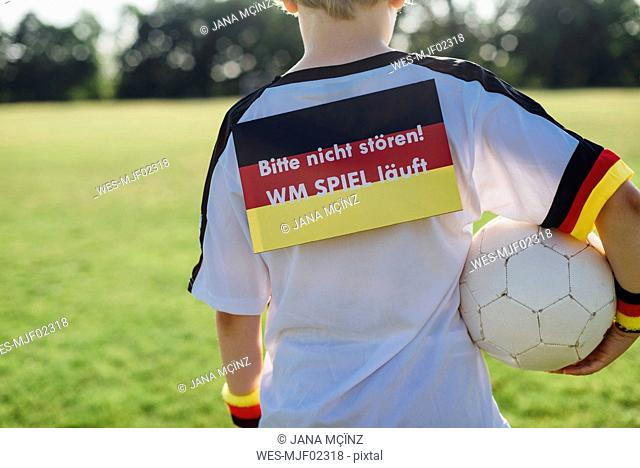 Boy showing do not disturb sign due to soccer world championship