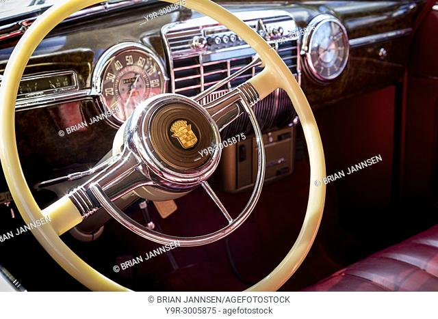 Front dash and steering wheel of a 1941 Cadillac on display at 'Cars on 5th' autoshow, Naples, Florida, USA