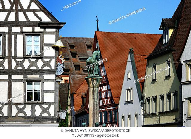 View for facades at Sattlertorstrasse from the town hall square, in front on left historic timber house with statue of Virgin Mary