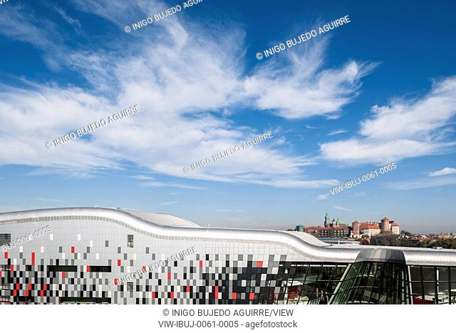 Outline of sloping roof with cityscape beyond. ICE Krakow Congress Center, Kraków, Poland. Architect: Ingarden & Ewy, Ararta Isozaki, 2014