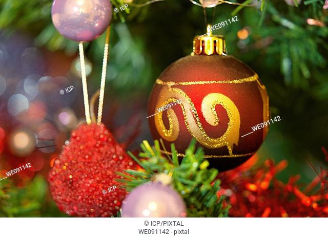 Christmas tree bauble decorations with tinsel