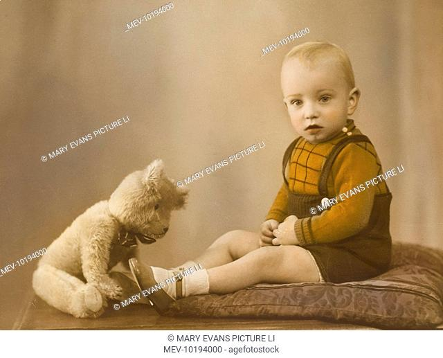 A young boy (Barrie Godfrey) pictured in this delightful portrait photograph with his favourite teddy